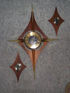 Sputnik inspired clock with additional decorative pieces.