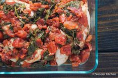 Weight Watchers Zero Point Slow Cooker Tomato Balsamic Chicken with spinach in a glass baking dish.