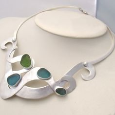By The Sea Jewelry - Sea Elf Necklace - Rare Sea Glass In Classic Bezel, $2,800.00 (http://bytheseajewelry.com/sea-elf-necklace-rare-sea-glass-in-classic-bezel/)