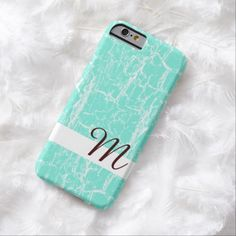 A stylish aqua mint and white slim #iPhone6case with a wood crackle pattern. This rustic distressed wood design with a girly twist can be personalized by adding your monogram initial.