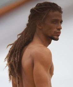 Locked back Free - what a beautiful man. as long as he isnt white, I love long dreads