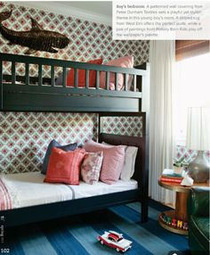 turquoise bunk beds, striped rug, nautical touches