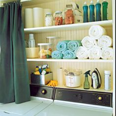 Hidden storage behind a half curtain - perfect for DIY shelves between studs in the basement