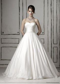 Silk chiffon and silk dupioni circular cut ball gown with sweetheart neckline, a draped waist and a gathered bodice.