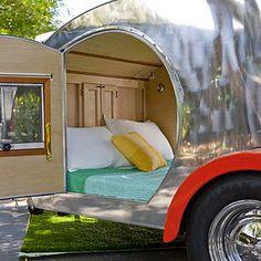 Teardrop queen size bed in trailer.