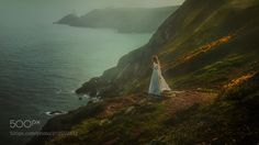 Howth - This was taken in lovely Ireland. Howth is without a doubt one of my favorite shooting locations. The sea cliffs covered in grass and flowers make for a pretty picture! I guess Victoria standing there helps it a little too :)  Lightroom Presets http://ift.tt/2pgD44L Photoshop Tutorials http://ift.tt/2pef0P6