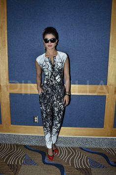 Priyanka at Child Rise at IIFA wearing a Yigal Azrouel jumpsuit.