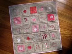 Christmas Advent Calendar. I love the red stitching against the background. I think I will be making one of these soon for this coming Christmas season.