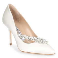 Ivory satin embellished pump from Manolo Blahnik. The Nadira has a stiletto heel, a beige leather insole, and an elegant crystal embellishment.True to sizeLeather soleMade in ItalyDesigner colour: Ivory 020 Blue High Heels, High Heels Stilettos, White Pumps, Blue Pumps, Manolo Blahnik Heels, Satin Pumps, Stiletto Pumps, Fashion Heels, Bridal Shoes