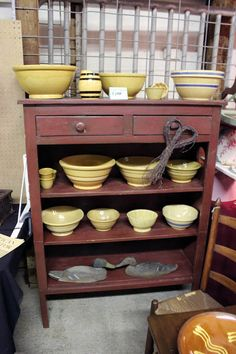 Primitive cupboard filled with yelloware pottery at the Ann Arbor Antique Market in Saline, Michigan