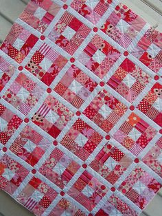 This is a 9 Patch! I like the simplicity of the pattern and the quilting. Would make a wonderful baby  blanket.