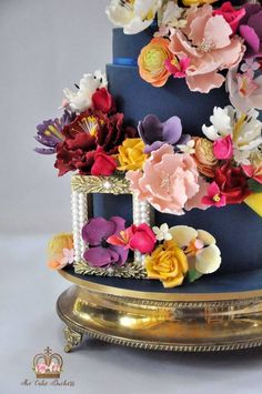 It is with great pleasure that I present to you: Floral Wedding Cake:The Garden of Eden My creation portrays the vivid beauty and enchanting magnificence of The Garden of Eden. What dreams are made of… My style is influenced by Modern Baroque...