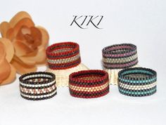 Beaded ring, peyote ring, seedbead metallic line patterned ring with stylish colours in band style unique handmade beadwork Diy Jewelry Rings, Diy Rings, Seed Bead Jewelry, Bead Jewellery, Beaded Rings, Beaded Jewelry, Loom Bracelet Patterns, Bead Loom Bracelets, Bracelet Crafts