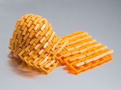 Experimental chainmail.  You can download and print one of the example files, or download the script to generate a custom size.  The chainmail in the pictures is printed 1.2 or 1.5 times the default size. Printer: -- Afinia H480* Filaments: -- Octave Gold ABS -- Afinia Orange ABS *affiliate link