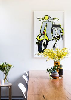Original Jasper Knight Vespa painting, reclaimed timber table by Blueprint via The Design Files.