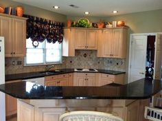 Peacock Kitchen Decor | Peacock Granite on Light wood kitchen cabinets - traditional - kitchen ...