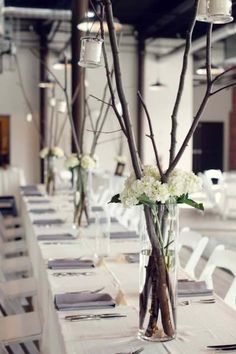Twig centerpieces - but be cautious of arrangements too high - they get in the way of seeing folk opposite and in photos they can intrude