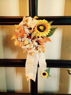 Small sunflower wreath.  Base is made out of burlap ribbon and orange ribbon strips. Added sunflowers, birds, butterflies.  More at https://www.facebook.com/Moje-vence-995508700482994/