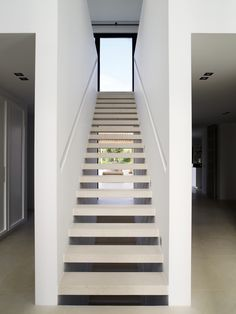 staircase inside a private house by Dutch designer Piet Boon.  floating treads paired with recessed handrail