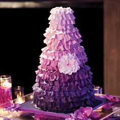 Jada & Jason in Orlando, FL The purple ombré cake was finished with a sugar flower.