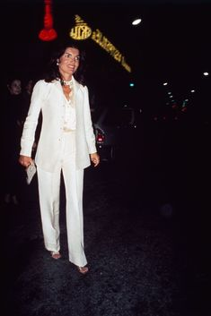 30 Photos Of Jackie O. From The Early Days Of American Street Style #refinery29 http://www.refinery29.com/2016/12/132751/jackie-kennedy-vintage-style-outfits#slide-28 Of course, what slideshow of first lady style would be complete without a white pantsuit?...