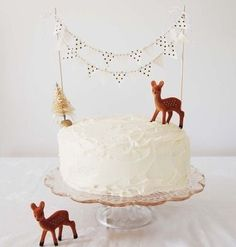 Really simple--plain white cake made special with mini-bunting and toppers. That's an affordable alternative to decorated cakes.