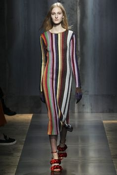 In the 1990's designers such as the Japanese (1994) started to play with more color, or at least more combinations of color. In this image we see just that. The dress has vertical lines of a variety of dark and brighter colors, yet it all comes together nicely.