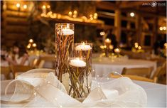 Pretty warm candle light table decor at a rustic wedding reception at a log cabin called Evergreen lake house in Colorado mountains. - April O'Hare Photography http://www.apriloharephotography.com