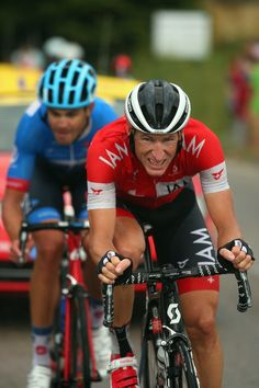 NIMES, FRANCE - JULY 20: Martin Elmiger of Switzerland and IAM Cycling leads Jack Bauer of New Zealand and Garmin-Sharp in the breakaway during the fifteenth stage of the 2014 Tour de France, a 222km stage between Tallard and Nimes, on July 20, 2014 in Nimes, France. (Photo by Bryn Lennon/Getty Images)