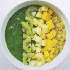Green smoothie bowl: spinach, banana, pineapple, lime and water topped with kiwi, pineapple, mango and passionfruit