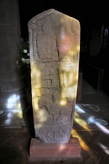 The Pictish Aldbar Stone cross slab stood for many years in the old chapel at Aldbar.  It is an upright cross carved from red sandstone, with relief carvings on both faces. The Aldbar Stone probably dates to the 9th or 10th century.  Located at Brechin Cathedral, Brechin, Scotland.