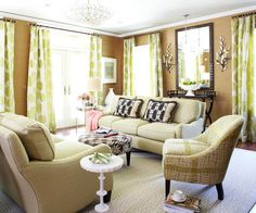 Stretch the perceived height of a room by hanging curtains below crown moldings instead of directly above window frames. This trick unites transom-topped French doors and windows in this family room, allowing the eye to travel around the room's perimeter without interruption. Positioning the sofas in the center of the room, rather than pushing at least one up against a wall, also creates a sense of space and creates multiple ways to pass through the room.