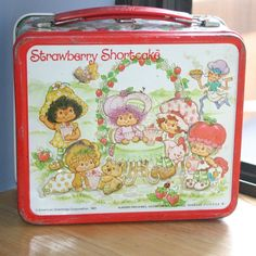 strawberry shortcake metal lunch box- I HAVE this still! It was my fave & sits on my desk at work!!