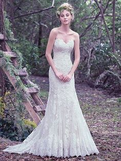 Maggie Sottero - jennita, This fit and flare wedding dress features hand placed shimmering embroidered lace appliqués on tulle and a sweetheart neckline. Complete with covered buttons over zipper and inner corset closure. Lace and tulle detachable train sold separately.