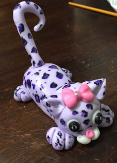 A personal favorite from my Etsy shop https://www.etsy.com/listing/293439529/purple-cheetah-cake-topper