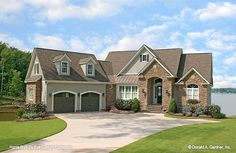 Plan of the Week Under 2500 sq ft - The Silvergate house plan 1254-D! 2401 sq ft | 4 Beds | 4 Baths Arched openings over the garage doors and a metal accent roof are just two of the thoughtful exterior details that lend curb appeal to The Silvergate home plan. #wedesigndreams #craftsmanhouseplan 5 Bedroom House Plans, Basement House Plans, Lake House Plans, Dream House Plans, Walkout Basement, Garage House, European House Plans, Country Style House Plans, Farmhouse Style