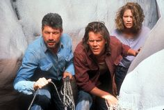 TREMORS.  Here they are trying to get off the rocks without alerting the worms.  The film is so cheesy it's brilliant.