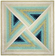 "Coastal Sunrise Illusion quilt, 54 x 54"", at Quilt Broker. The ten colorful fabrics vary from a deep sea turquoise and blue flower motif to an off-white-on-white floral print."