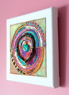 Embroidered and embellished textile art on canvas