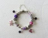 Bracelet européen argenté breloque perle cristal rose violet femme : Bracelet par sylviane-bijoux