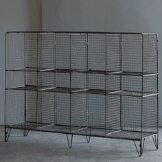 """Convenient storage with a nostalgic twist – our Wire Gymnasium Shelving Unit is perfect for kids' rooms, game rooms or any room frequented by a sports fanatic. Great for storing and organizing a variety of items including toys, books, games and sporting equipment. Flattens for shipping and allows for varying shelf room.  Dimensions: 48""""w x 12""""d x 34""""h"""