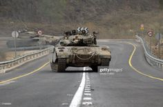 News Photo : Israeli tanks roll along a deserted road close to. Army Vehicles, Armored Vehicles, Sites Like Youtube, Cool Tanks, Battle Tank, Video Site, Magazine Ads, Modern Warfare, Cold War