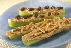 Peanut Butter Celery Sticks - Top these peanut butter and celery sticks with raisins, pretzels, cranberries or chocolate chips – the possibilities are endless! Bread Appetizers, Yummy Appetizers, Appetizer Recipes, Skippy Peanut Butter, Peanut Butter Recipes, Easy Snacks, Healthy Snacks, Healthy Recipes, Lunch Recipes