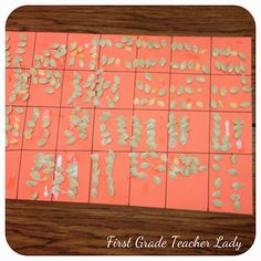 First Grade Teacher Lady.  We did a similar activity with Sunflower Heads.  I like the grid.  We had cut down egg cartons(10) to have a place to set our counting sets.