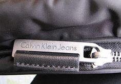 Calvin Klein. Bag zipper puller.