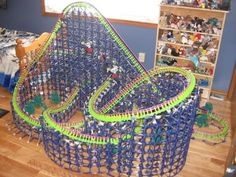 A K'nex wooden twister style roller coaster. Lego Train Tracks, Lego Trains, Rolling Ball Sculpture, Planet Coaster, Roller Coasters, Kitchen Benches, Crafts For Kids, Education, Beads