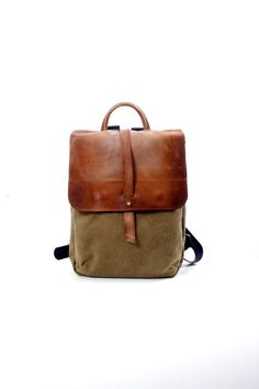 A sturdy and practical backpack for every laptop user. Or just for general perpose . Great for school and work!  This canvas and leather backpack is a