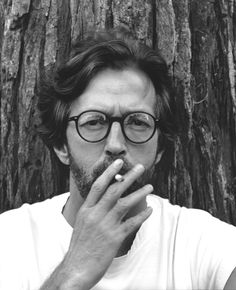 Eric Clapton smoking a cigarette (or weed)