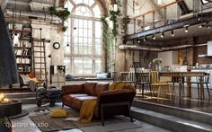 Old factory converted in apartment. Modern LOFT by Quattro Studio. Sofa Kanaha di Ditre. Contemporary iron fireplace.