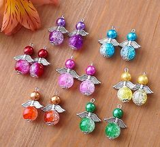 14 Angel Charms Pendants 2 Tones Crackle Round Beads Wings COLOURS MAY VARY